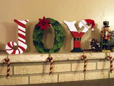 Standing holiday letters for a mantle or shelf.
