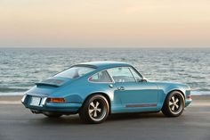 Light blue #Porsche 911 at the beach.