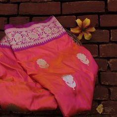 Orange-Pink Pure Katan Silk Banarasi Handloom Saree - Look your radiant best in this gorgeous silk saree with sunflower motifs. Cast a little bit of sunshine and happiness on everyone around you! Charming floral weaves, with love from Banaras.