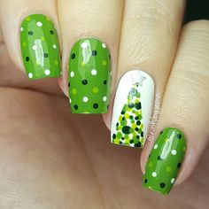 A new spin on an old design of mine  I love these dotted trees and they are so simple to do. Paired with a shades of green dotticure, it's a cute green Christmas design!  Products used: OPI 'I'm Sooo Swamped', 'Christmas Gone Plaid', 'Alpine Snow', China Glaze 'Def Defying', What's Up Nails Regular Straight Tapes & Star Stickers and dotting tools.  Tutorial will be up later  #25daysofchristmasnailsbyjema