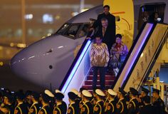 Indonesian President Joko Widodo and First Lady Iriana Widodo disembark from their plane at Beijing's international airport on Nov. 8, 2014 as they arrive to take part in the Asia Pacific Economic Cooperation (APEC) Summit.  (AFP Photo/Greg Baker)