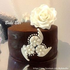 Edible Art of the Day Winner for Thursday, July 25 Pratyusha Mukherjee.  Simple is beautiful- A fathers day cake, simple chocolate cake filled with strawberry mousse, ganached and decorated with fondant flower and accents!  Congrats Pratyusha!!!