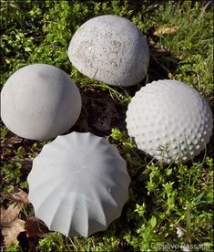 Use old glass light globes, fill with concrete, then break the glass - makes great mushroom caps