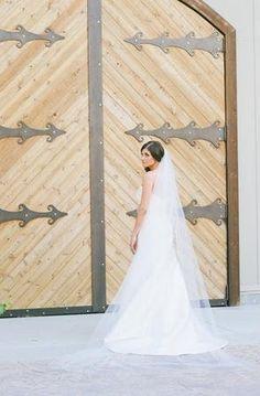 Long romantic veil at a barn wedding (Photo by Weston Neuschafer Photography)