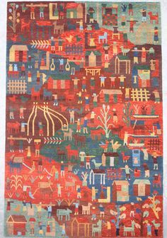 """This charmin and colorful """"village"""" rug was woven in Nepal in 100-knot (fine) Tibetan weave, of handspun, natural-dye wool. There are a limited number of these very special rugs available at any one time. We can have one custom-made for you in any size. Click to view all of these village scene natural-dye rugs."""