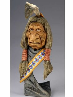 """"""" Broken Feather """", carved by Caricature Carvers of America member Gary Falin."""