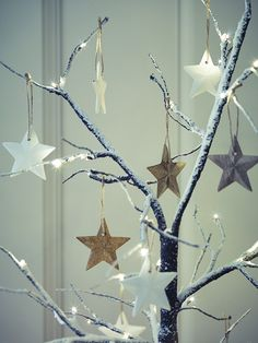 Carefully hand crafted from mango wood with a jute string for hanging, our set of six three-dimensional hanging stars include three with a natural finish, and three with a white wash finish. Display on our Frosted Light Up Trees for a nature-inspired Christmas look.