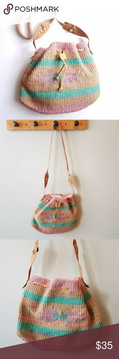 Boho Vtg Jute bag pastel pink teal green crossbody Great boho style vintage bag. Made of woven tan jute with a Southwestern pattern in pastel pink, purple, and teal. Long strap can be worn crossbody. Lined inside with ivory color linen. Drawstring closure. Strap seems to be real tan leather, may be man made. In like new condition. Clean inside and out. From a smoke free home. Offers welcome :)   POSHG8288bag6f5f5 Vintage Bags Crossbody Bags