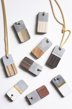 DIY Concrete and Wood Veneer Necklace Tutorial from Tinker Paint Bake Cakes.Make these modern DIY Concrete and Wood Veneer Necklaces using silicone jewelry molds. There isn't much of a tutorial, but modeling clay was used to adhere the veneer to the concrete base. There is also a recipe for champagne chalk paint at the link.For hundreds of Jewelry Ideas go HERE.