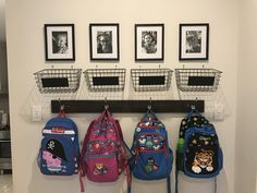 School bag storage. Baskets from Kmart for school notes and a photo above each hook! Total cost $50!