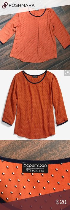 """Papermoon Dauwens crew neck blouse in burnt orange Loose fitting crew neck blouse from Papermoon.  Burnt orange blouse with navy trim on collar and sleeves. Rounded hem.  All over flower-like pattern in navy, rust and creme.  Shirt does not stretch.  Size M 3/4 sleeves Bust 20"""" Length 26"""" Papermoon Tops Blouses"""