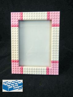 This LEGO® picture frame is perfect to show off the personality of anyone who loves Lego and having fun! Alternatively, the frame could be used for as a small dry erase board. The frame will hold a ph