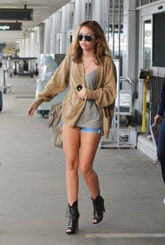 Miley Cyrus / relaxing casual. An oversized boyfriend sweater is the perfect companion for air travel!