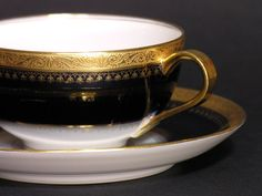Vintage beautiful tea cup and saucer made by Théodore Haviland Limoges in the 20s Hight quality French porcelain gilded in fine gold Dark blue and white Photo 1 and 2 there is a reflection of the saucer on the cup, its not a defect! In excellent vintage condition No signs of use,
