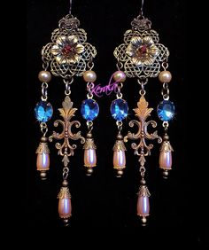 These handmade chandelier earrings measure 4 1/2 long x 1 wide. Theyre made with hand-set sapphire crystal jewels, creamy pearlescent drops, Victorian
