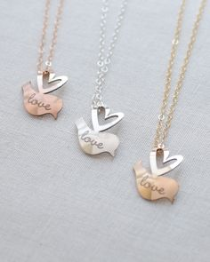 Personalized Lovebird Necklace by Olive Yew. Tell everyone who your sweetie is with a personalized lovebird necklace. This cute little lovebird charm flies right into the heart of its owner and can be beautifully engraved with your sweetheart's name or left blank.