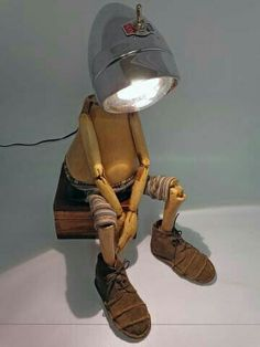 This lamp is very creative and thinking out of the box. Even though, the lightning effect is not that different from typical lamps the design of the lamp makes it interesting and i may be able to use the idea of the way they used the wood in this product. Junk Art, Metal Art, Desk Lamp, Art Desk, Room Lamp, Bed Room, Puppets, Lamp Light, Repurposed