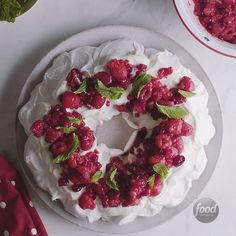 This edible wreath is almost too pretty to eat (but seriously, you should dive in -- it's delicious.) Crisp and crunchy meringue lies beneath a ruby red cranberry, raspberry and pomegranate sauce. Pavlova, Cookie Desserts, Dessert Recipes, Food Network Recipes, Cooking Recipes, Delicious Desserts, Yummy Food, Christmas Baking, Christmas Desserts