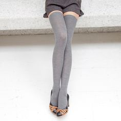 Grey thigh-high knit socks  gray shorts gray skirt - great for winter layers  Denise Salceda .Com  a model herself fashion pictures  http://denisesalceda.com/perfect-for-chilly-weather-second-edition-knit-socks-tights-stockings/