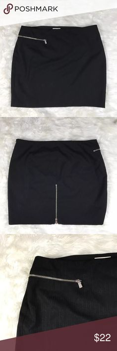 "Michael Kors black wool blend mini skirt size 16 Michael Kors women's size 16 black wool blend mini skirt with exposed silver zippers. Gently used condition. Smoke free home.    Waist 38"", length 19"" Michael Kors Skirts Mini"
