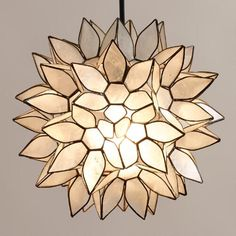 One of my favorite discoveries at WorldMarket.com: Small Capiz Lotus Hanging Pendant Lantern