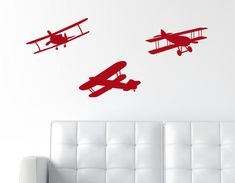 This decal pack includes three biplane decals.  These airplanes would be a great addition to a kid's bedroom!  These airplane decals would also go really well in a playroom.  Brought to you by The Wall Lab!