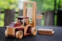 Wooden fork lift and flat bed truck toy made out of purpleheart wood
