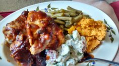 Barbecued chicken, dilled cucumber/tomato salad, mashed sweet potatoes kissed with maple syrup, and country grean beans, by ME!