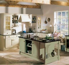 Kitchen Design, Delightful Country Kitchen Pictures With Antique White Kitchen Cabinet And Table Also Black Granite Countertop Also Classic Green Kitchen Island With Black Countertop Color Also Beige Vintage Tile Flooring Design: Using Country Style Kitchen Design To Make Your Kitchen Looks Unique