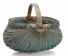 WOVEN-SPLINT BASKET, white oak, kidney form with double rim, arched handle with complex stepped supports, and fancy woven-over base rib. Outstanding original dry blue-painted surface.  Late 19th/early 20th century.  Shenandoah vALLEY