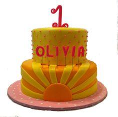 Sunshine Birthday Cake in lemonade colors, yellow and pink. Strawberry cake with lemon buttercream and chocolate cake with buttercream, enrobed in fondant, gumpaste topper. July 2013, Silver Cake Studio, Houston.