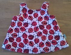 Just what your little one needs for the summer, a gorgeous lined pinafore dress. This dress is lined with calico and is 10 inches long, should fit a 6 - 12 month old.