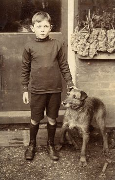 Vintage boy and dog. Not sure what that is under his shirt...