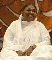 Amma, the Mother of All.  Hugs for everyone.  <3 - My daughter and i both got a hug from her in Dublin 2007 - something special happened that day <3