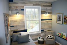 """We're with you if the term """"wood paneling"""" gives you flashbacks to The Brady Bunch rec room. But the owners of this house went in a totally different direction with that outdated standby, using rustic boards from (free!) shipping pallets and giving them a pretty whitewashed stain. Get the tutorial from East Coast Creative"""