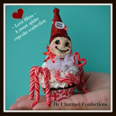 SOLD!  Charmed Confections' LeeAnn Kress has a new whimsical piece available - this is a Love Bite.  A cute spider confection made on a faux cupcake, sculpted head and polymer clay legs that look like real candy.  To purchase go to www.pfattmarketplace.com and look for Charmed Confections