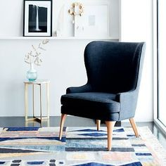 Furniture: chair. I like the curves to off-set a straight couch. I also love the navy color. Owen Wing Chair #westelm