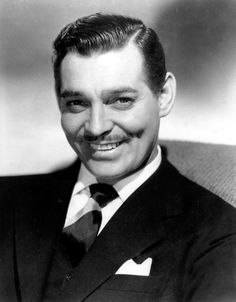 """CLARK GABLE    Clark Gable, often remembered for his good looks, pencil mustache and commanding screen presence, was a staple of Hollywood's golden age of film. Regarded as the """"The King of Hollywood"""" in his prime"""