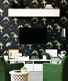 love those green chairs, love that wallpaper, and I love the way the TV dissappears into the wall