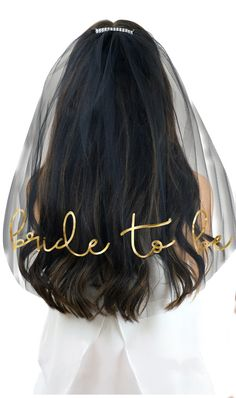 This pretty bachelorette veil has a metallic gold graphic on a black tulle veil (also available in white and mint green!) for the Bride to be! #bridetobe #bride #wedding #bridalshower #veil #goldwedding