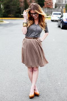 I'm almost convinced I want a skirt like this now.  Also, the glasses, duh!