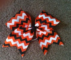 This listing is for one cheer bow.    This bow is made with 3 Grosgrain Ribbon attached securely to an elastic band. All ends have been heat