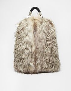 Bag by Echo Leather-look fabric Faux fur finish Contrast textile lining Grab handle Zip around opening Adjustable straps Wipe with a damp cloth 60% Acrylic, 40% Polyester