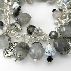 Chain bracelet with silver, stone, and crystals wire wrapped like a charm bracelet.