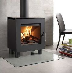 The Westfire Uniq 23 stove is a DEFRA approved clean, modern design with a large glass area and is available in a range of style options. Multi Fuel Stove, Stove Fireplace, Wood Burner, Modern Fireplace, Living Room Modern, Home Look, My Dream Home, Property For Sale, New Homes