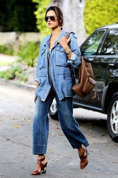 3 New Ways Celebrities Are Wearing Denim-On-Denim #refinery29  http://www.refinery29.com/celebrity-denim-outfit-trend#slide-1  Alessandra Ambrosio goes for a laid-back look with a zipped-up denim parka from RtA and retro flares from Citizens of Humanity. The slouchy fit and frayed edge on the jacket (which give it a vintage flair) contrast with the structure of the wide-legged jeans. ...