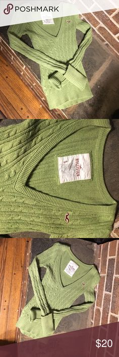 Size small Holister v neck green sweater V neck Hollister that fits tightly and has long arms that can fold up or that can be worn as going over the top of the hand. The v neck is pretty deep. The fit is tight as a small or could even fit someone as an x-small. Hollister Sweaters V-Necks