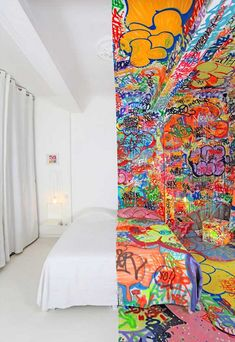 Awesome hotel room: half minimalist white/half crazy graffiti. Holy duality, Batman!