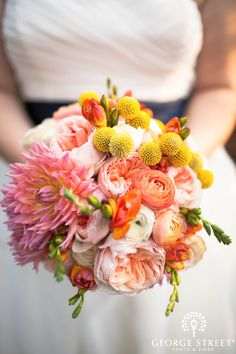 Spring bouquet with hints of orange, pink and yellow! Beautiful!