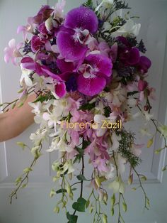 Cancun wedding flowers purple & white orchids bridal bouquet. #cancunflorist #floreriazazil